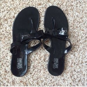 Black coach sandals with bow.